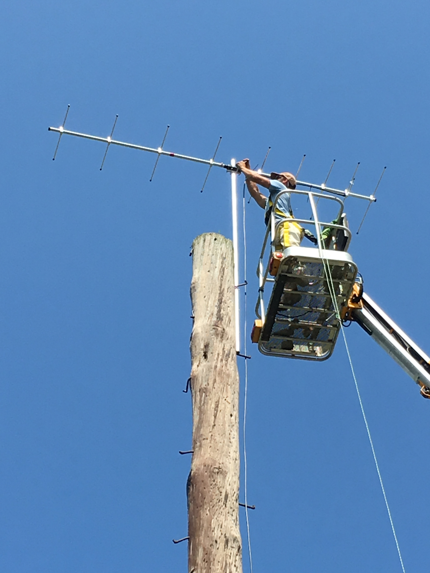 Todd Alleger works on a receiver station from a rented cherry picker in Blue Marsh and Waggoner's Gap, PA.