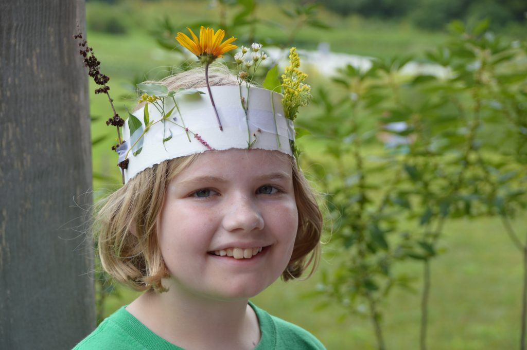 Rushton Nature Keeper wearing her nature headdress last summer.  Photo by Blake Goll/Staff